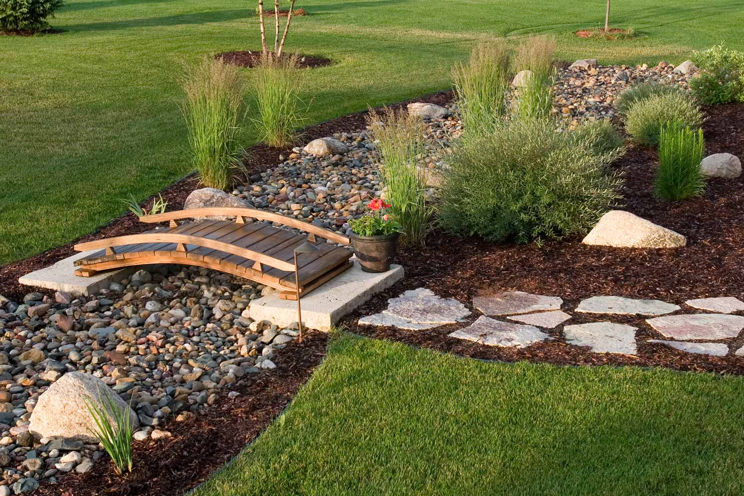 stone creek and garden manage landscape drainage