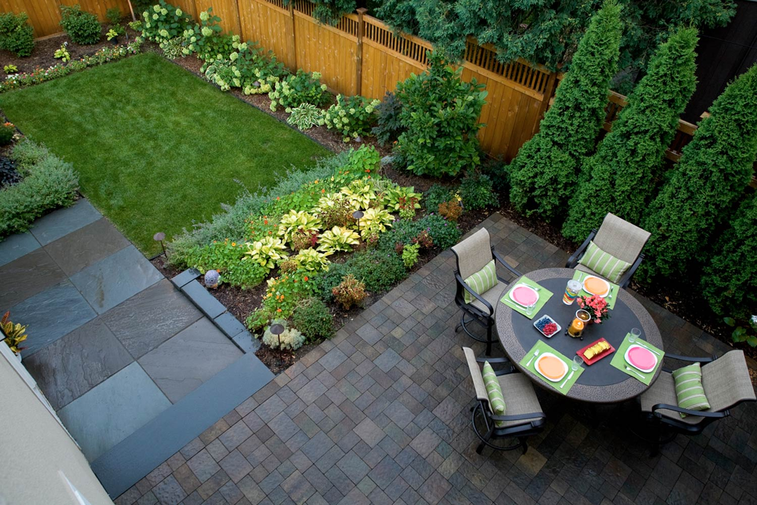 Contemporary formal backyard with edible and decorative plants in the garden.