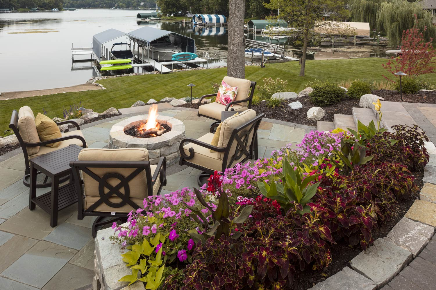 Colorful flower plantings on the fire patio
