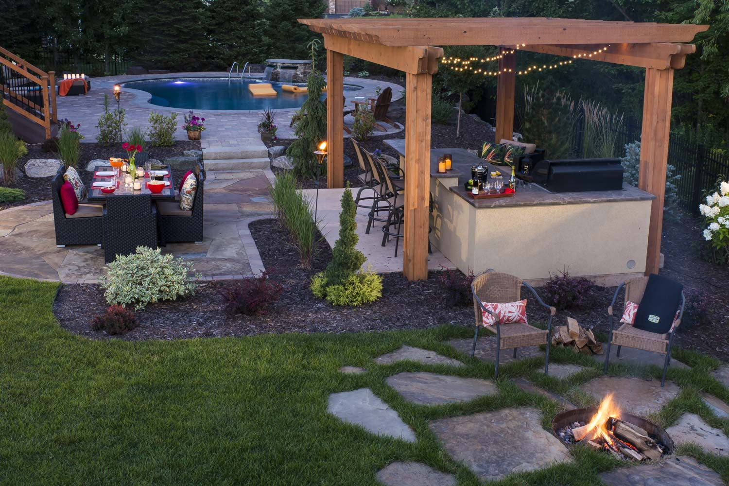dining patio, fire pit, and pergola over outdoor kitchen and bar