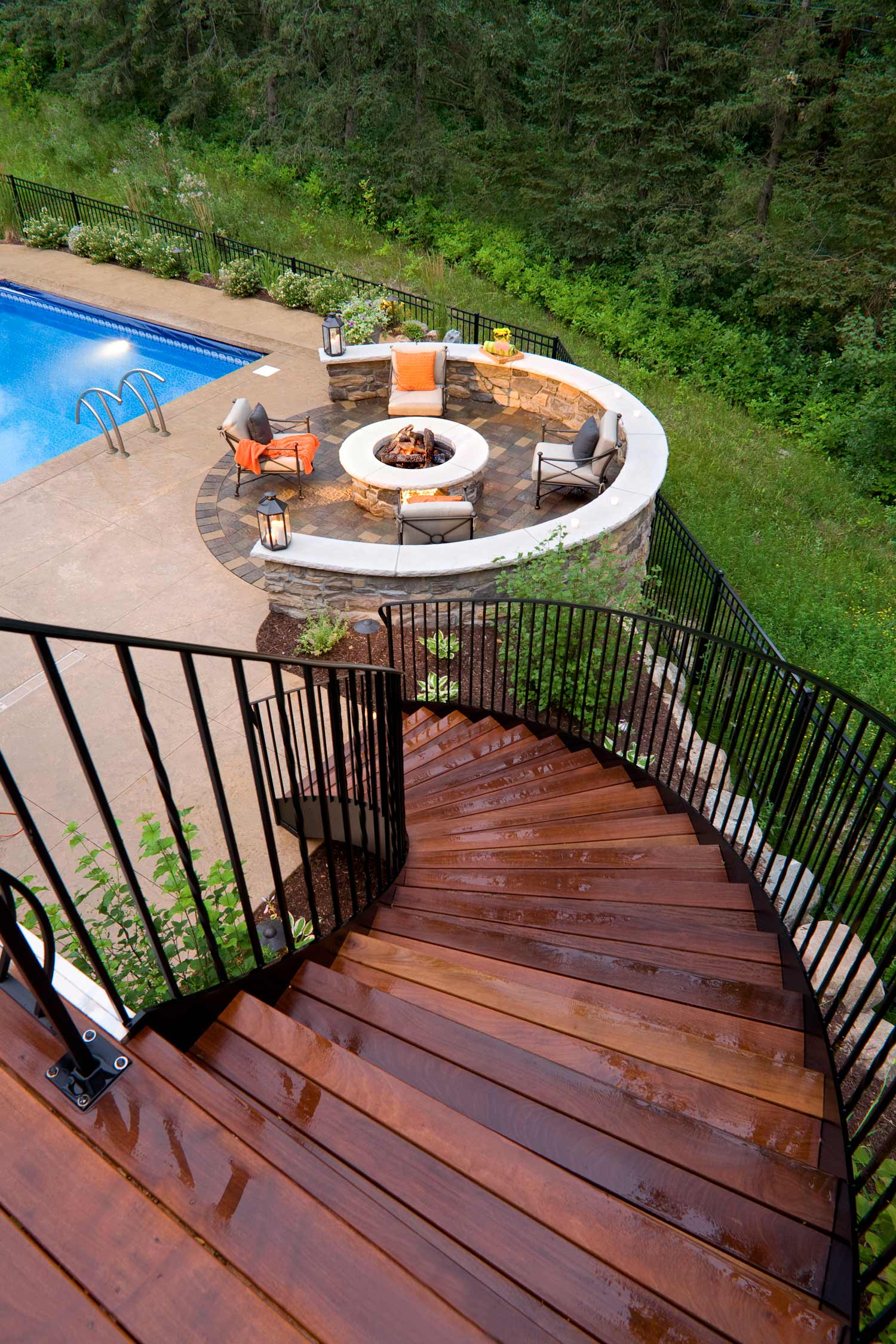 Curving staircase leads to a fire patio