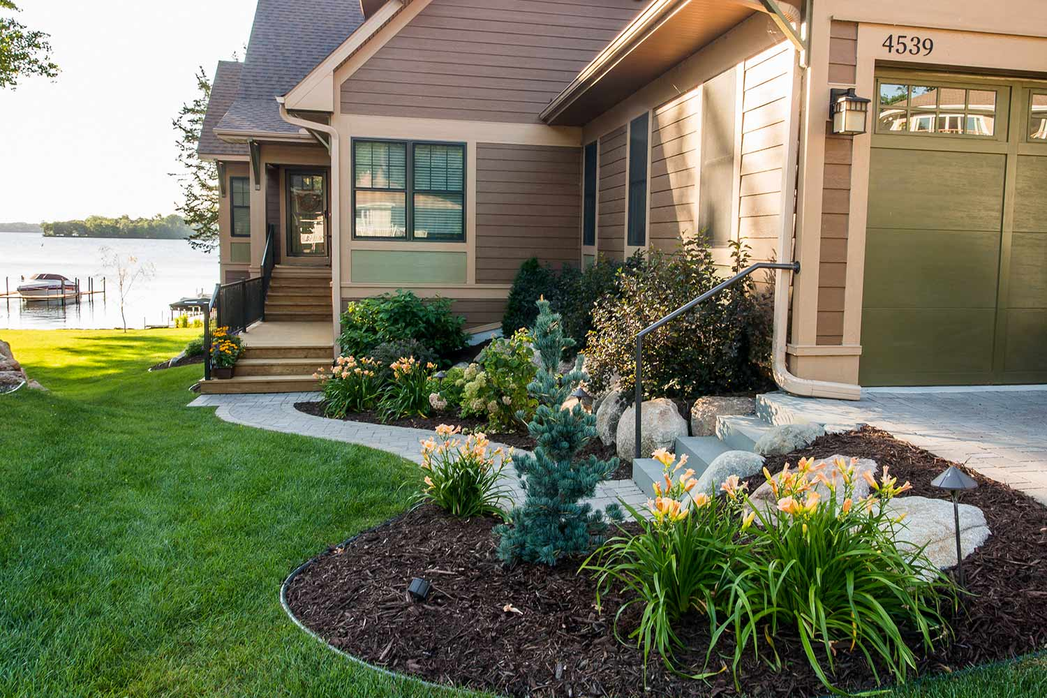 lakeshore front entry design with gardens