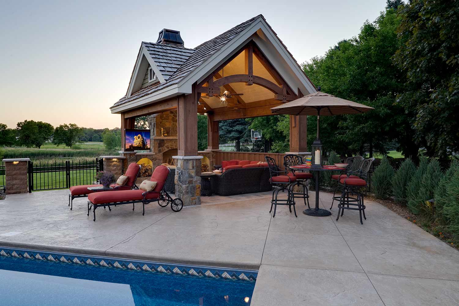 timber frame pool house structure with outdoor living room