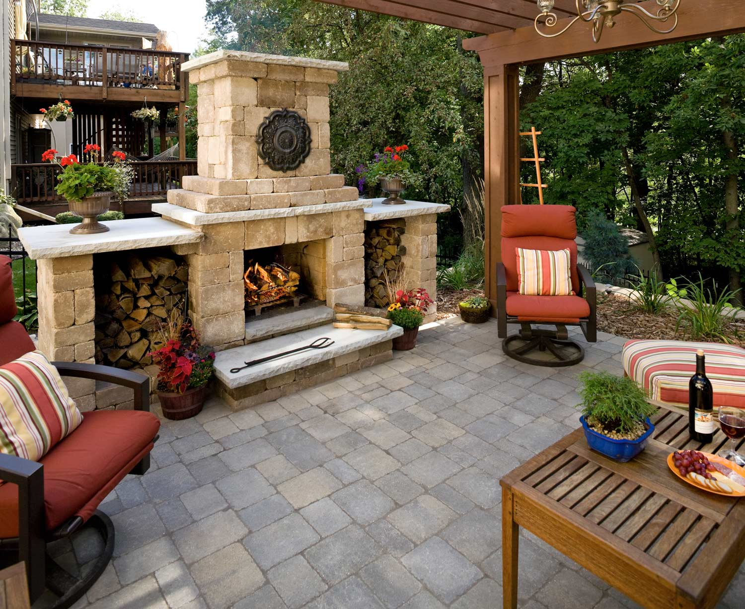 Pergola covers the entire patio in shade in this small backyard landscape in savage