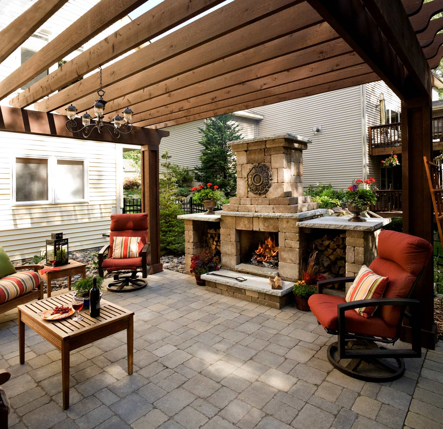 Pergola covers the entire patio in this small backyard landscape in savage
