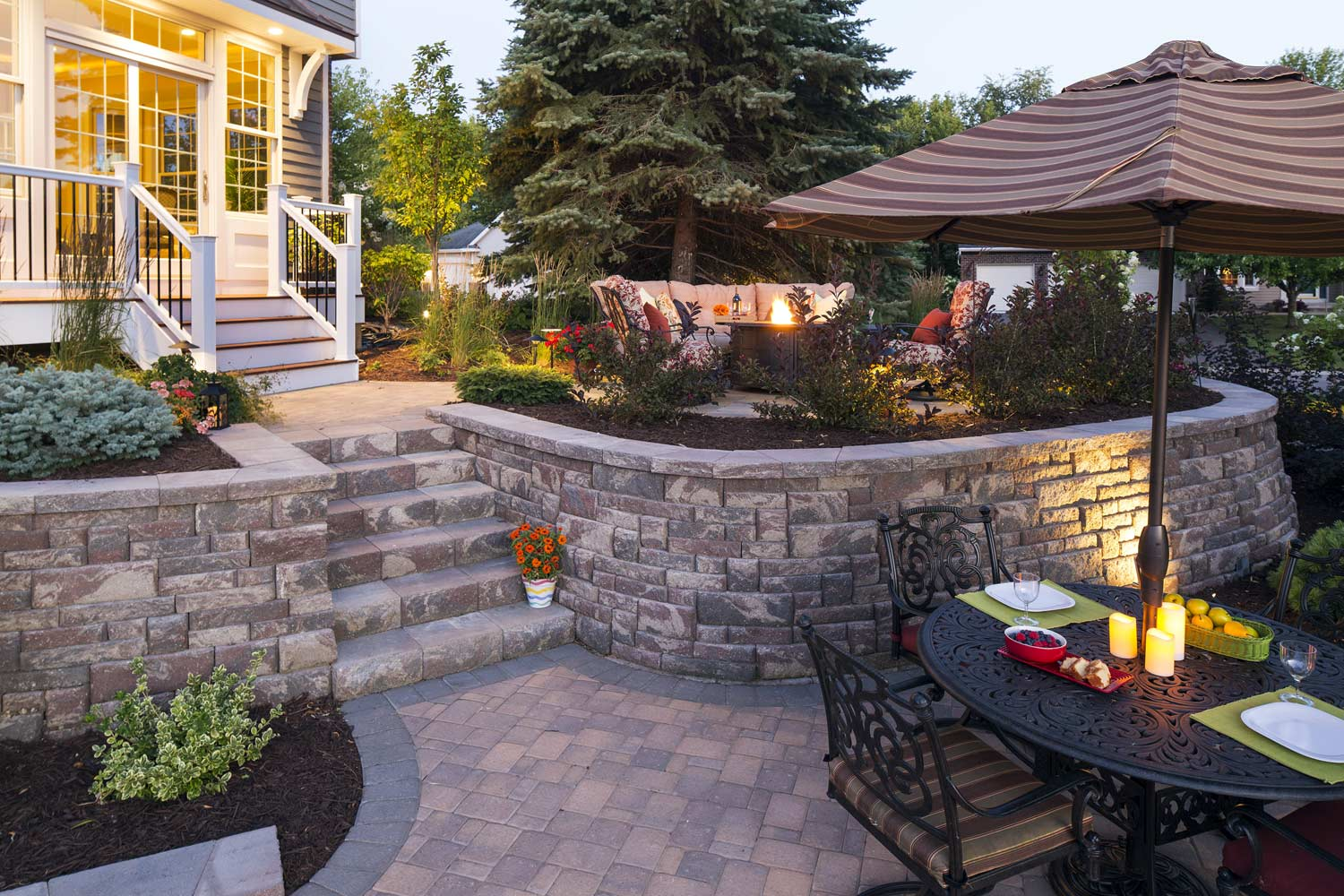 Modular block multi-level backyard retaining walls help manage this steeply sloping back yard