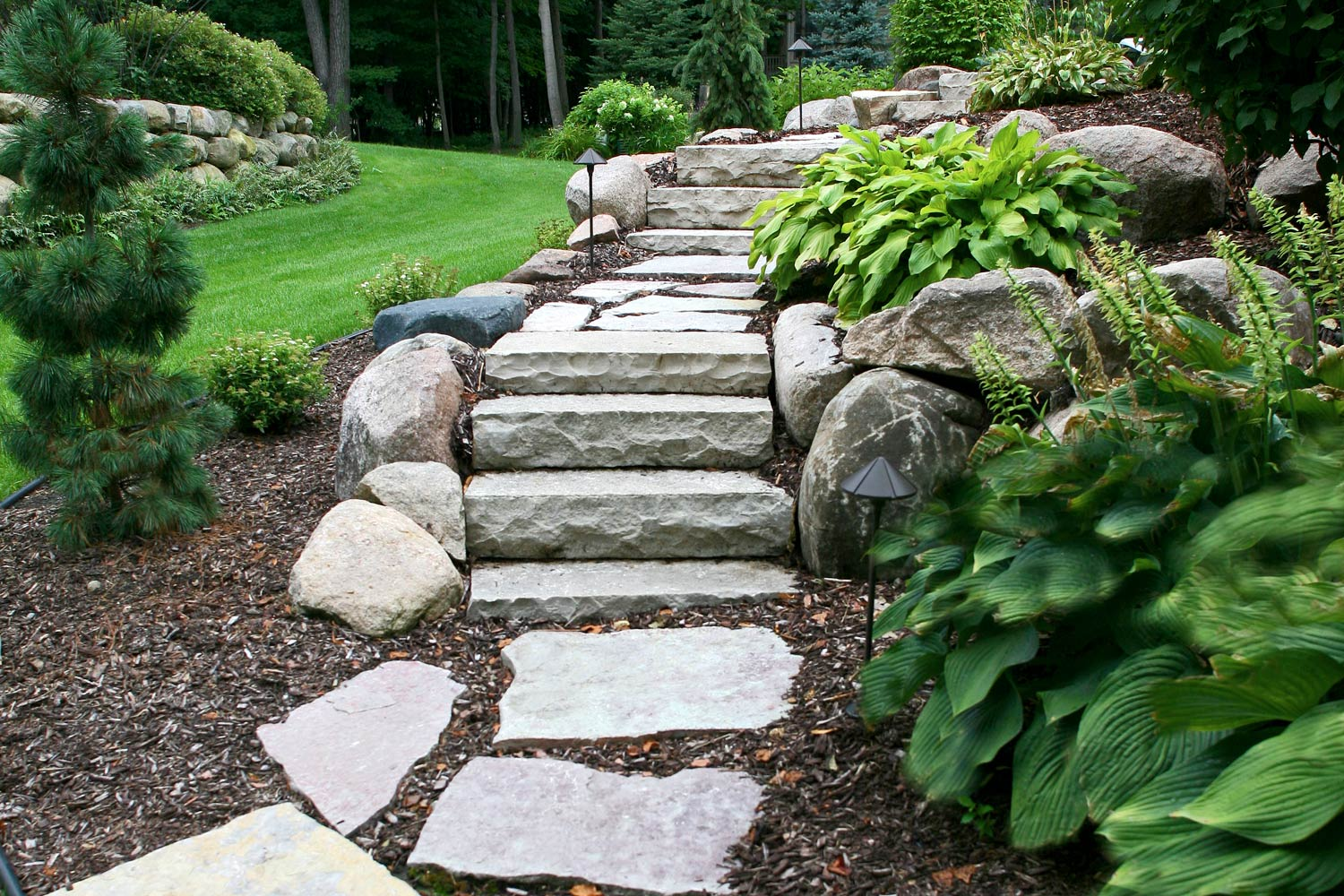 Natural stone steps with flagstone walkway.