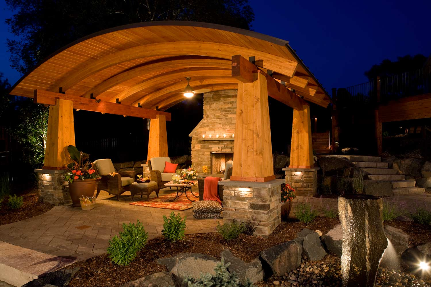Outdoor living room with elegant and arching architectural structure design in Woodbury, MN
