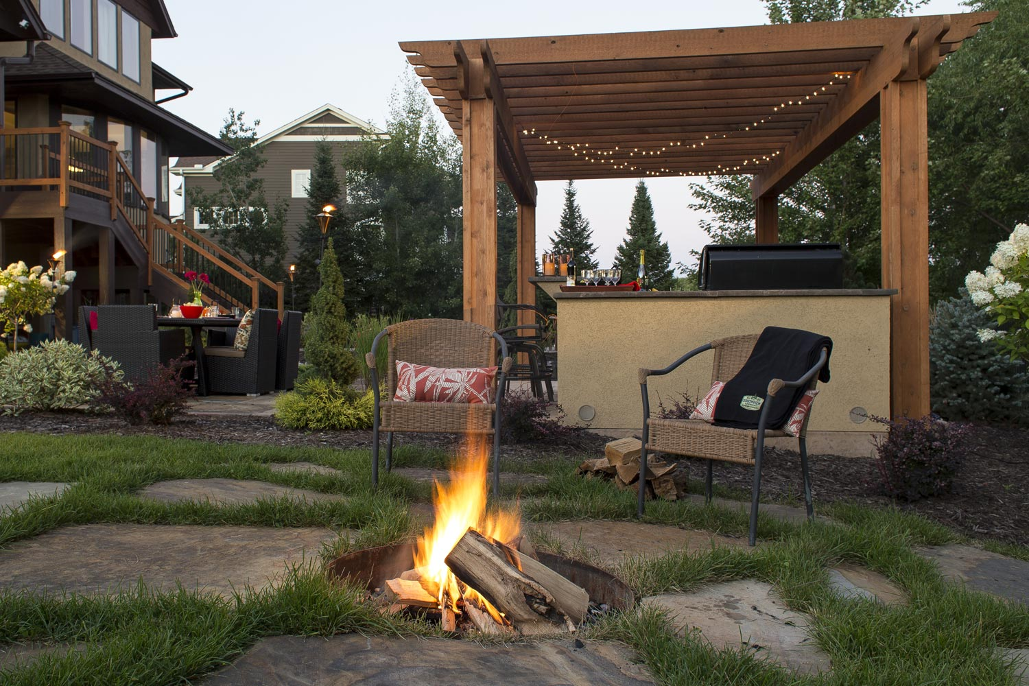 rustic in ground fire pit and chilton stone patio landscape design