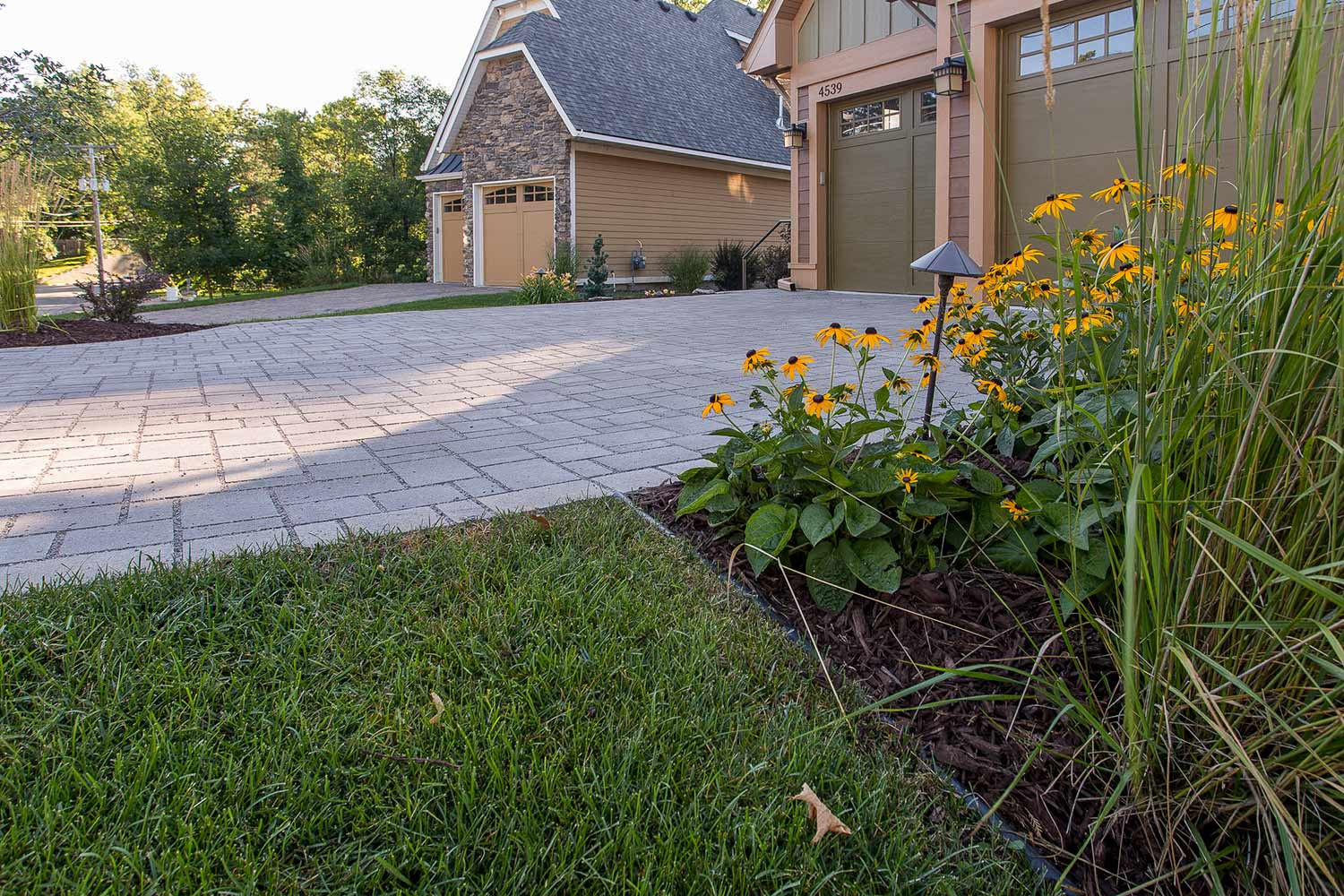 permeable lake house drive way and sustainable garden plants